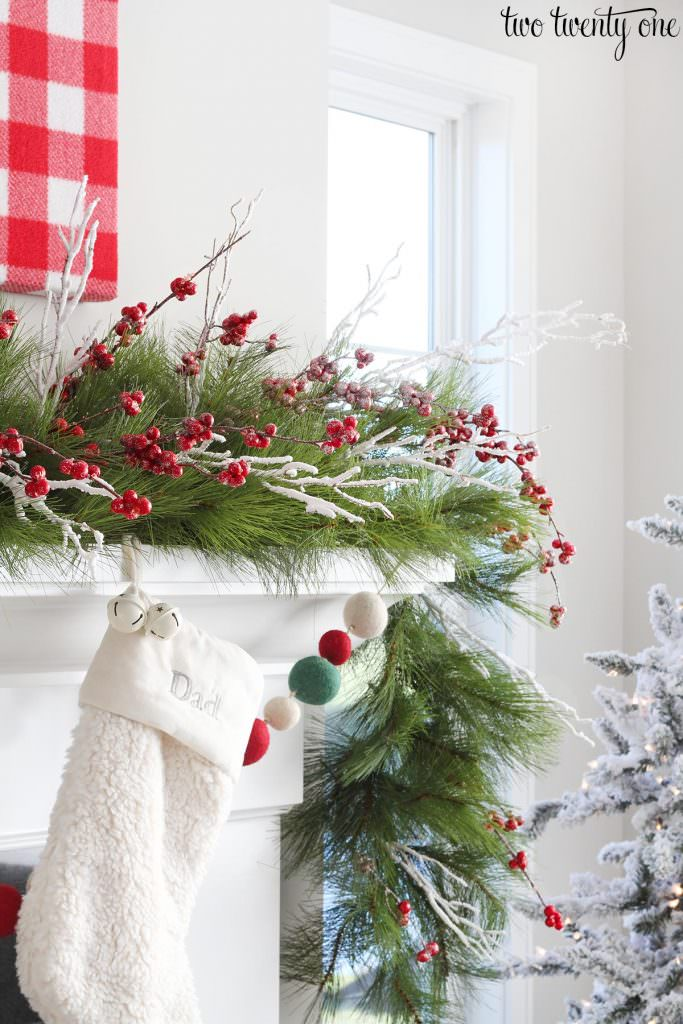 jump on the buffalo check trend with landeelu and try every single one of her warm and fun mantel decorating ideas here love this - Christmas Mantel Decorating Ideas