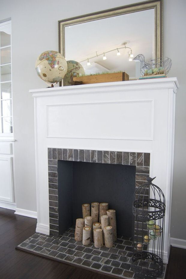 Diy faux fireplace the budget decorator for Building an indoor fireplace