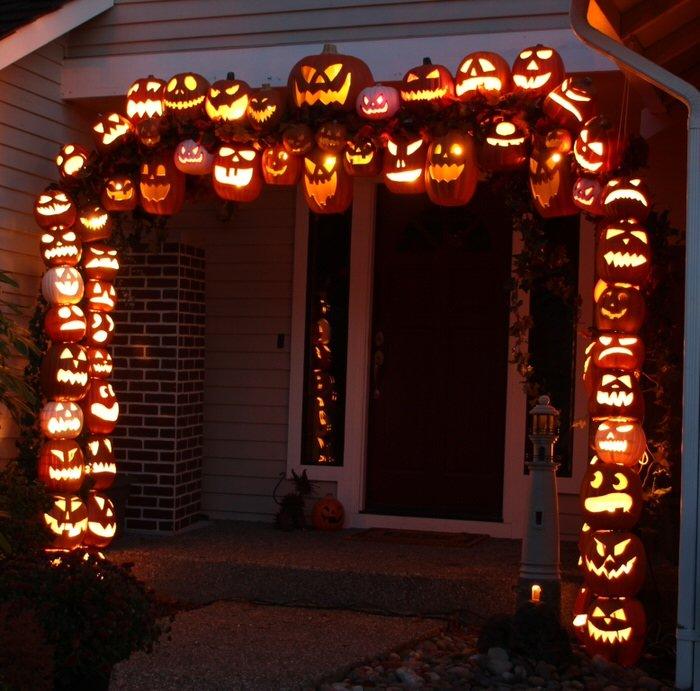 these halloween garage door silhouettes are made from basic plywood and a dremel tool or jigsaw