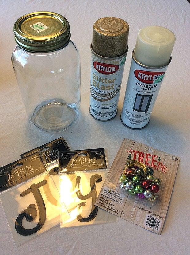 Diy mason jar holiday luminaria the budget decorator diy mason jar holiday luminaria solutioingenieria Image collections
