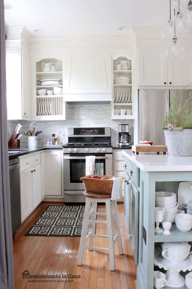 give your cabinets a more custom feel by adding kitchen counter posts and molding from  u0027cuckoo 4 design u0027  this is a simple afternoon project     diy budget kitchen makeovers   one project at a time  u2022 the budget      rh   thebudgetdecorator com