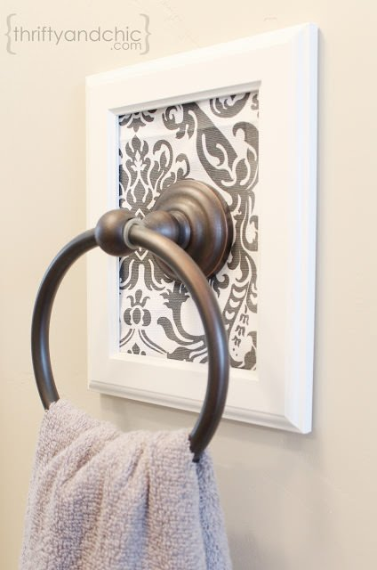 Alicia at 'Thrifty & Chic' updated her old hardware with a DIY framed towel holder. This project is simply a picture frame and some leftover fabric!