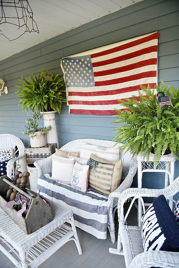 She Hung A Flag On The Wall Added Some Patriotic Fabric Covered Pillows And Striped Throw Little Flags Tucked Into Her Centerpiece Perfection
