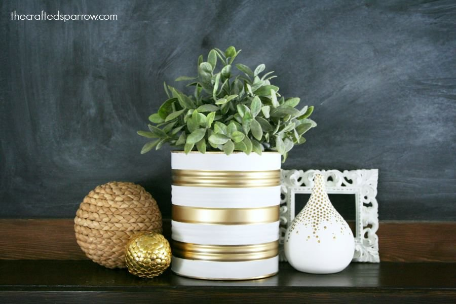 13 classy diy tin can decor projects the budget decorator for Tin can diy